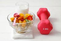 Muesli with fresh fruit,milk and hand weight