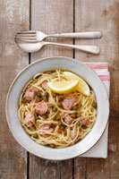 Spaghetti with tuna,capers and lemon and olive sauce