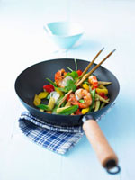 Prawns and vegetables in wok