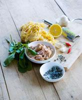 Various ingredients (ribbon pasta,tuna,spices,lemon)