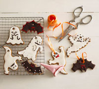 Halloween biscuits,ribbon for hanging,scissors