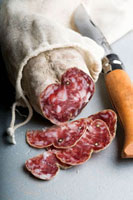 Salami�Cpartly sliced�Cwith knife