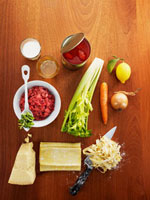 Ingredients for ribbon pasta with bolognese sauce