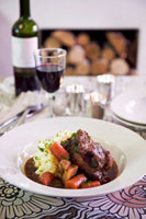 Braised oxtail with mashed potato and root vegetables