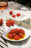 Oven-baked tomatoes with herbs and olive oil