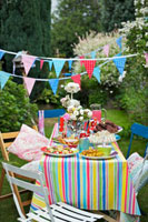 Table laid for children�fs party out of doors