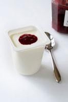 Yoghurt with jam in a plastic yoghurt pot