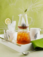 Iced tea in jug�Cice cubes and ice tongs