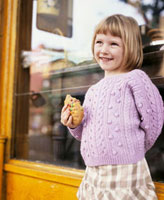Girl with a biscuit in her hand