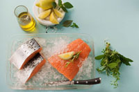 Salmon on crushed ice,olive oil,lemon,bunch of herbs
