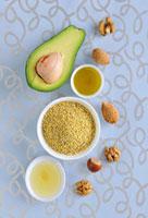 Healthy vegetable fats: nuts,avocado,millet,oil