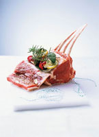 Stuffing prime rib of beef with herbs and spices