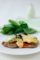 Veal steak with tomato sauce,avocado and melted cheese