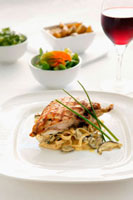 Chicken breast on ribbon pasta with mushrooms
