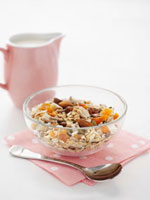 Muesli with nuts and dried fruit�Csmall jug of milk
