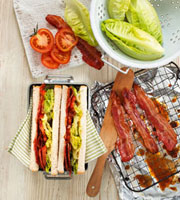 BLT sandwiches in lunch box�Cingredients beside it