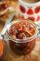 Tomato jam in preserving jar