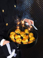 Chimney sweep serving deep-fried rice balls for New Year's