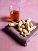 Peanuts on purple cloth