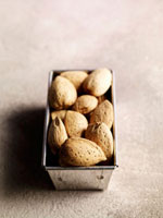 Several almonds in loaf tin