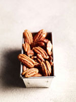 Shelled pecans in loaf tin