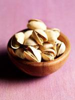 Pistachios in wooden bowl