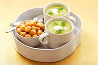 Cream of pea soup with mint and soup pearls