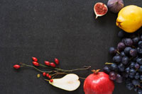 Still life with autumn fruit and branches of rose hips