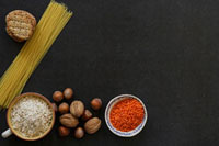 Still life with lentils,nuts,rice,spaghetti and cracke