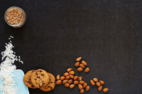 Still life with almonds,chocolate chip cookies,short-gra