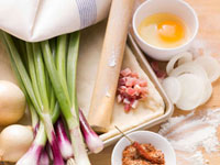 Ingredients for tarte flambee: spring onions,diced bacon,