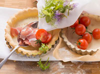 Ingredients for tarts: pastry cases,bacon,tomatoes,her