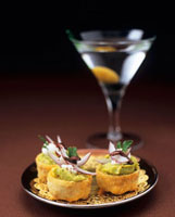 Small guacamole tarts,glass of Martini