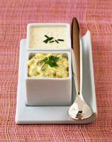 Tartare sauce and mustard sauce in dishes