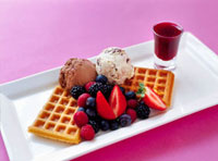 Waffles with ice cream�Cfresh berries and berry sauce