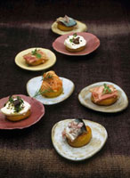 Potato canapes with meat in aspic,salmon,herring and goa