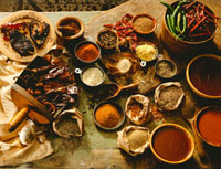 Variety of Spices and Sauces on Rustic Wooden Table