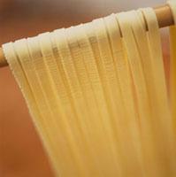 Fresh ribbon pasta hanging up