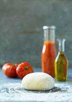 Pizza dough,tomatoes,ketchup and olive oil