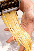 Home-made ribbon pasta on someone's hand