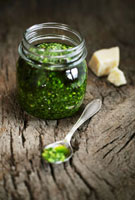 Pesto in jar and on spoon