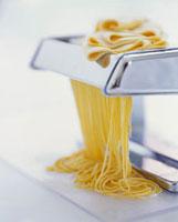 Running pasta through a pasta maker