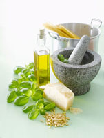 Ingredients for pesto,mortar and pestle,spaghetti in pan