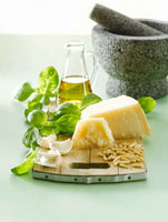 Ingredients for pesto on chopping board,mortar and pestle