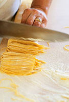 Making tajarin (thin egg pasta,Italy)