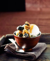 Vanilla ice cream with pecans,dates and caramel sauce