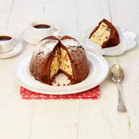 Sponge and ice cream cake (Zuccotto),a piece cut