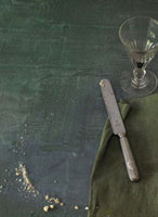 Bread curmbs,serviette,knife and a wine glass