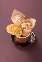 Millet,rice and rolled oats in paper bags