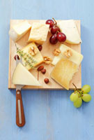 Various cheeses with grapes and nuts